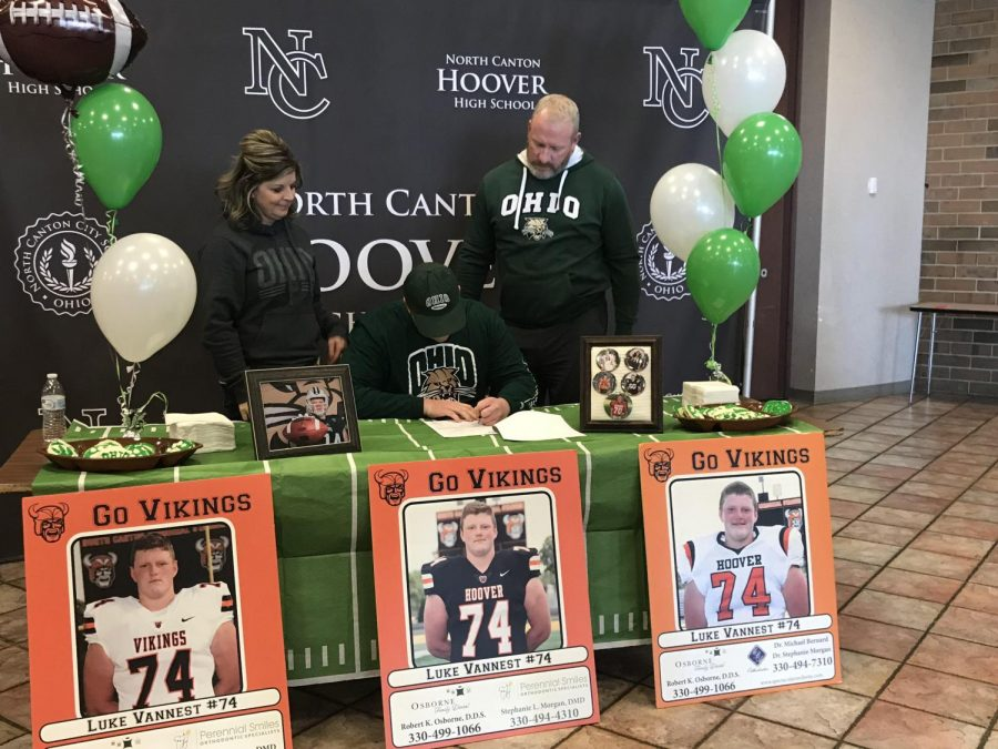 Luke Vannest, a member of Hoover's football team, signing his letter of intent to continue his football career at Ohio University next year.