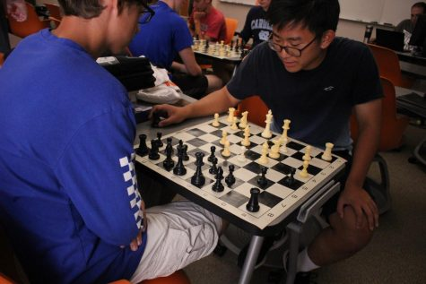 Senior Ricky Park contemplates his next move during a chess match.