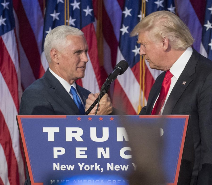 President-elect Donald Trump, joined on stage by running mate Mike Pence, speaks to supporters at the Election Night Party at the Hilton Midtown Hotel in New York City on Wednesday, Nov. 9, 2016.