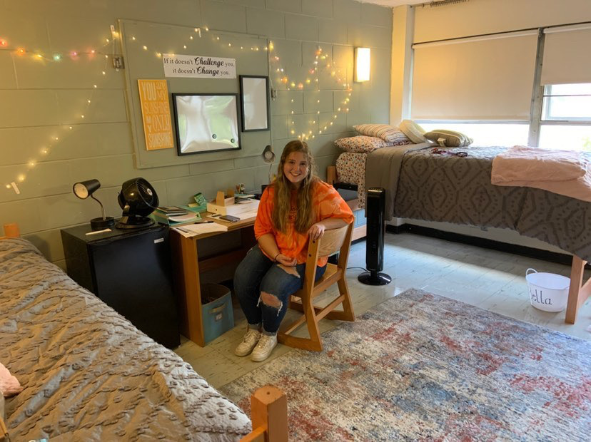 Class of 2020 alumna Bella Hayward sits in her dorm at Capital University