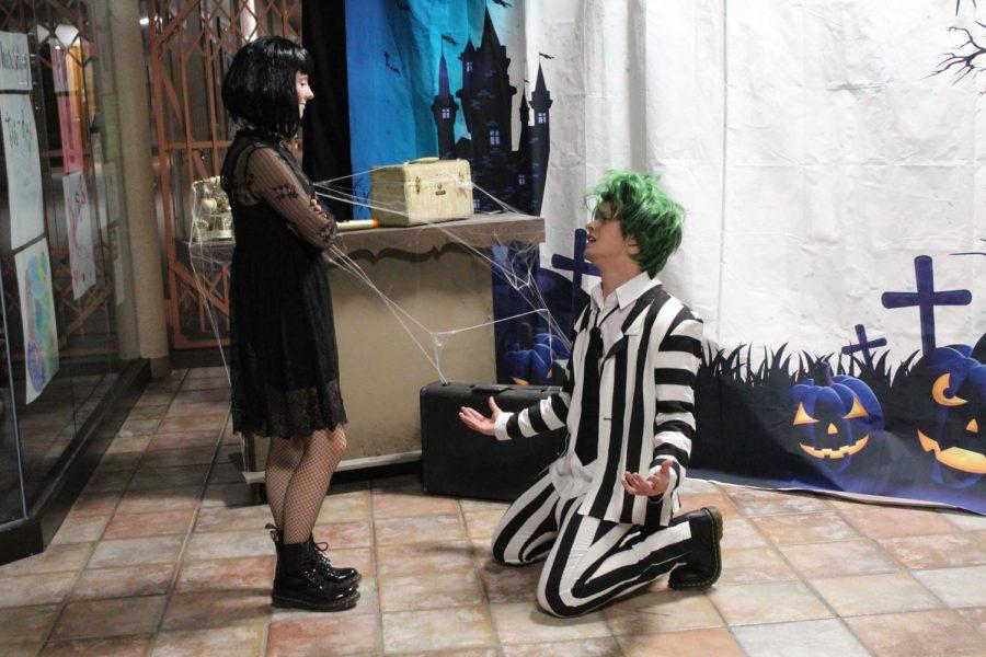 """Senior Saylor Tucker and alumnus Jon Semrau perform scenes from popular American movie """"Beetlejuice."""""""